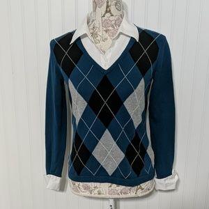 Faux shirt under argyle sweater cuffs and collar